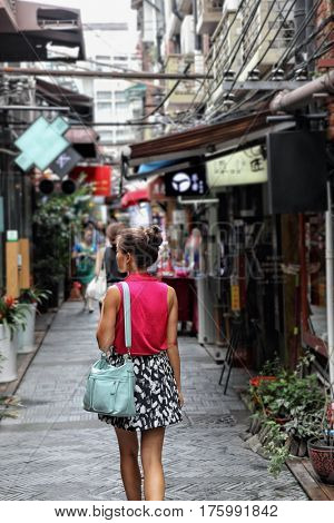Chinese woman walking in Shanghai shopping street. Tourist on china travel at Tian Zi Fang area in the French concession.