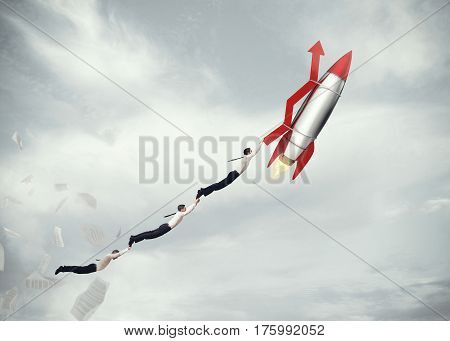 Businessmen flying attached to a missile with an arrow. take-off business success concept. 3D Rendering
