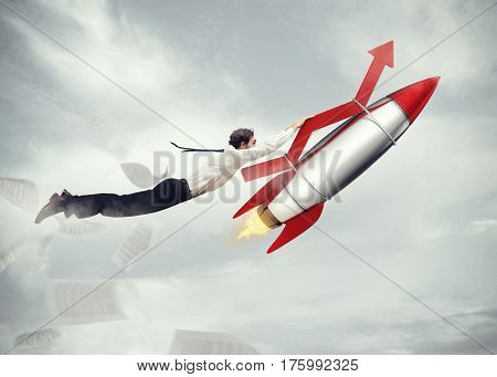 Businessman flying attached to a missile with an arrow. take-off business success concept. 3D Rendering