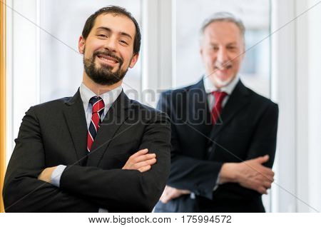 Smiling businessman in front of his boss