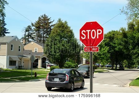 Stop Traffic Sign On Country Road. Suburban area