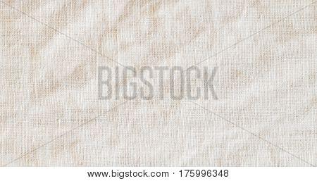 Vintage beige fabric texture background. Canvas close-up burlap.