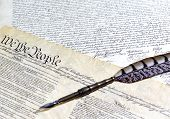 US Constitution Declaration of Independence with John Hancocks signature quill pen and shallow depth of field poster