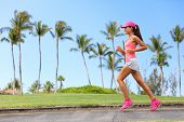 Healthy woman runner jogging on city sidewalk. Happy Fitness girl athlete working out living an active lifestyle training cardio in the morning running in pink sportswear, cap and shoes. Full body. poster