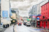 Rainy weather and a city. raindrops flow on window glass. buildings and cars are barely visible through the rainy mist poster