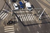 PRAGUE CZECH REPUBLIC - MARCH 3: Bird's eye view of cars crossing intersection with people walking on crosswalk on March 3 2017 in Prague Czech republic. Volkswagen unveils electirc self-driving van on Geneva Motor Show. poster