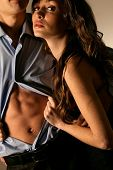 Emotional sexy scene young woman undressing her partner poster