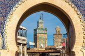 Minarets of Fes seen throuth Bab Bou Jeloud Gate - Morocco poster