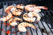 Delicious looking shrimp on the grill ready to eat poster