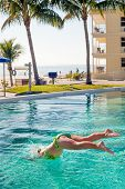 Jumping into the pool of beachfront condo in Fort Meyers, Florida poster