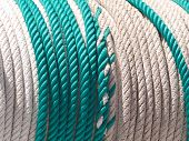 rope green and white on a drum or winder poster