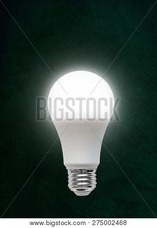 Illuminated Energy Efficient Light Emitting Diode Led Light Bulb Isolated On Chalkboard Background W