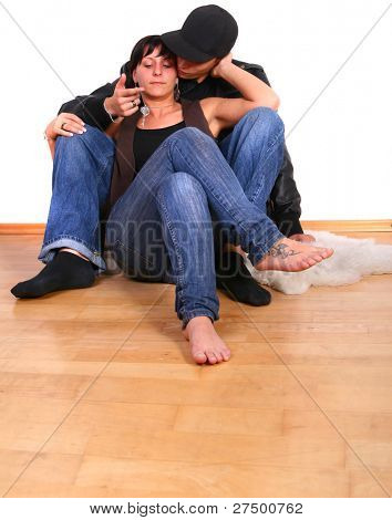 Young couple in hiphop / emo style hugging each other. Isolated over white.