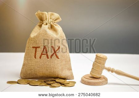 Bag Of Money And The Word Tax And Hammer Of The Judge. Law Concept. Court And Judgment. Justice And