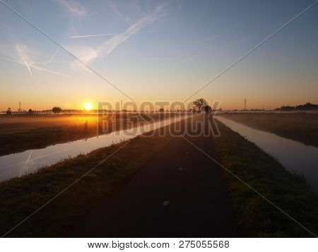 Sunrise With Morning Fog Over The Meadows Of The Polder At Goudarak Close To Gouda In The Netherland