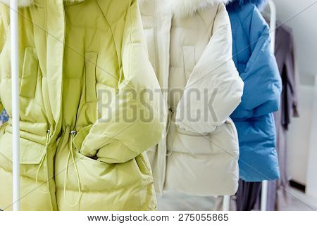 Fashion Winter Coats Hanged On A Clothes Rack