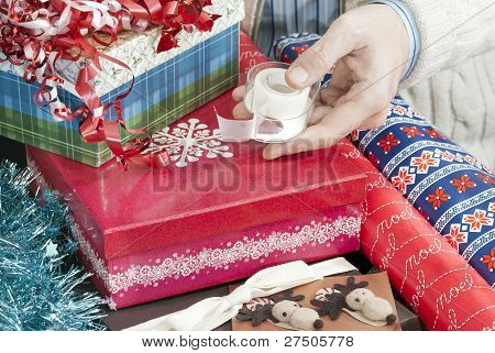 Man Holds Christmas Gift Wrapping Tape