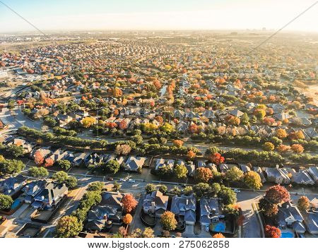 Top View Residential Neighborhood And Sprawl In Autumn Season In North Of Dallas