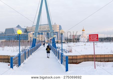 Russia, Surgut, 12/20/2018: Bridge Over The River Saima. Church Of The Holy Martyr Tatiana. Students