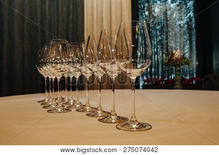 Wine Glasses, Served For Dinner In Restaurant With Cozy Interior. Catering Service On A Large Table