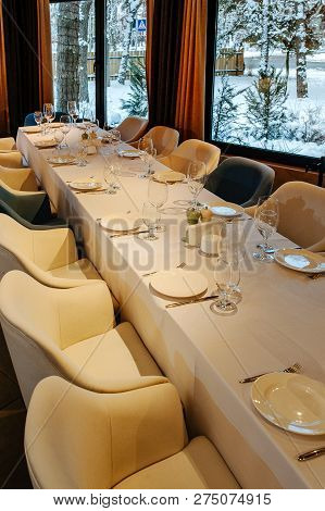 Tableware For New Year Banquet. Glasses, Plates, Fork, Knife,served For Dinner In Restaurant With Co