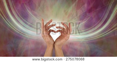 Sending Out Love Vibrations - Female Hands Making A Heart Shape With A Stream Of Energy Flowing Eith