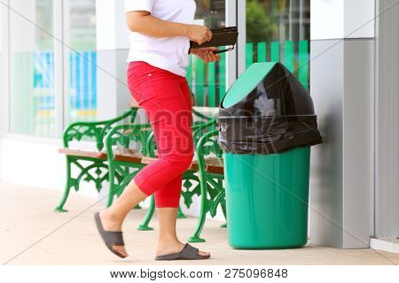 Plastic Bin Green For Waste At Front Store Shop, Garbage Waste Bin And People Are Walking Through Th