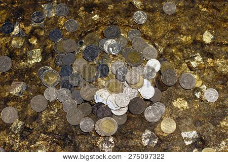 abstract of many thai coin money making merit for background (selective focus), thailand money coin for faith faith in buddhism have good luck poster