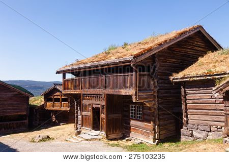 Old traditional Norwegian wooden sod roof houses at Maihaugen Folks museum Lillehammer Oppland Norway Scandinavia poster