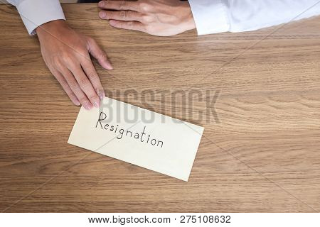 Businessman sending letter will being resignation and carrying packing belongings company and files into brown cardboard box, changing and resigning from work concept. poster