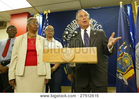 NEW YORK - AUGUST 15:  New York City Mayor Michael Bloomberg (R) speaks about heat related issues affecting New Yorkers at the Wakefield Senior Center on August 15, 2005 in Jamaica, New York City, NY