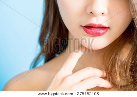 Closeup Of Sexy Beauty Lips Isolated On Blue Background