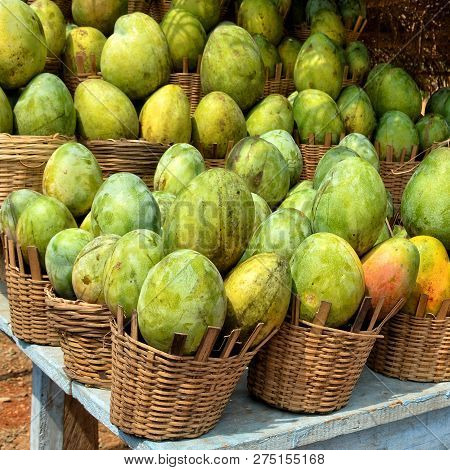 Mango In Baskets On Display For A Sale. Close Up. Market Stall. Organic Food. Beautiful Image.