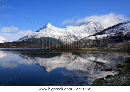 The Paput of Glencoe reflected in Loch Kinlochleven poster