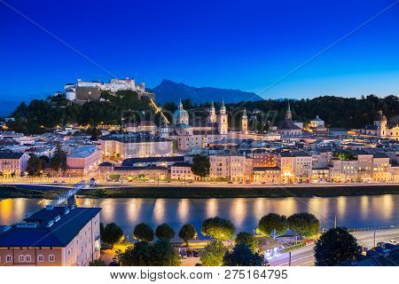 View Of Cityscape Of Salzburg Cathedral, Fortress Hohensalzburg, And Old Castle In Center Of Old Tow