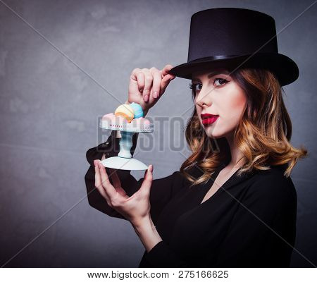 Style And Mystique Redhead Girl In Top Hat With Marshmallow On Grey Background