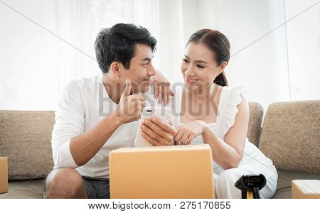 Young Couple Working With Their Small Business