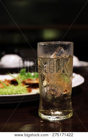 Cold Beer In Glass And Ice And Food On Table, Beer Is Beverage Alcohol In Foods Shop Night Time (sel