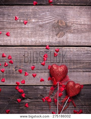 Two Red Decorative  Hearts On Vintage Wooden Background. Selective Focus. Place For Text. Flat Lay.