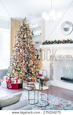 Christmas Living Room With A Christmas Tree And Presents Under It