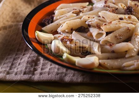 Pasta With Minced Meat, Garlic And Onion In Navy-style On Yellow Wooden Table. Makarony Po-flotski,