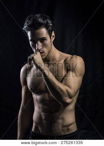 Handsome Muscular Shirtless Young Man Standing Confident