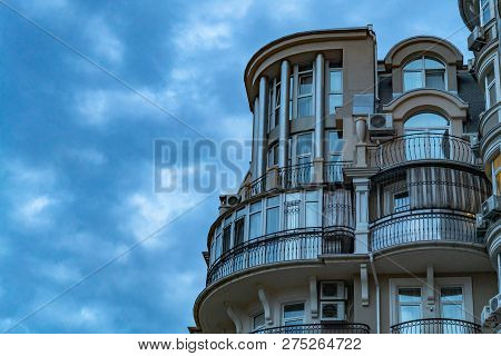 Modern condo buildings with huge windows. Luxury residential real estate on the coast. poster