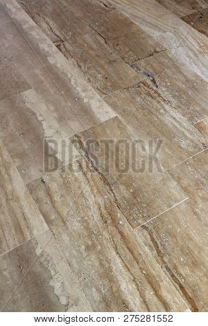 Floor Made Of Rectangular Beige Marble Slabs