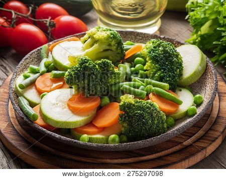 Mix Of Boiled Vegetables, Steam Vegetables For Dietary Low-calorie Diet. Broccoli, Carrots, Cauliflo