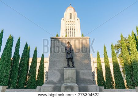 Status Of Abraham Lincoln Outside The Nebraska Capitol Building In Lincoln Against A Blue Sky