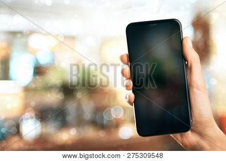 Hand Holding Empty Smartphone