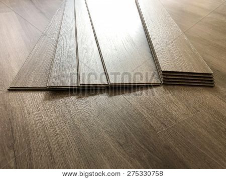 Modern floor in the luxury lobby of office or hotel. Real floor tile pattern with reflections for background. Shiny floor after professional cleaning. flooring tool