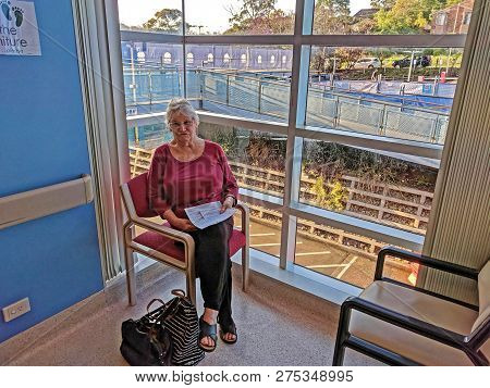 Gosford, New South Wales, Australia - October 23, 2018: Senior Lady Patient Seated In The Cardiac Wa