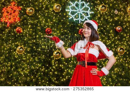 Happy Smiling Santa Girl Is Cute In Red Suit With Christmas Tree Background Celebration In Christmas